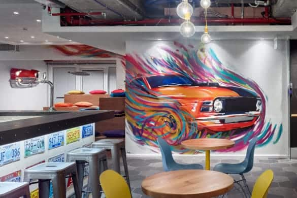 Breakout area with multicoloured car wall art