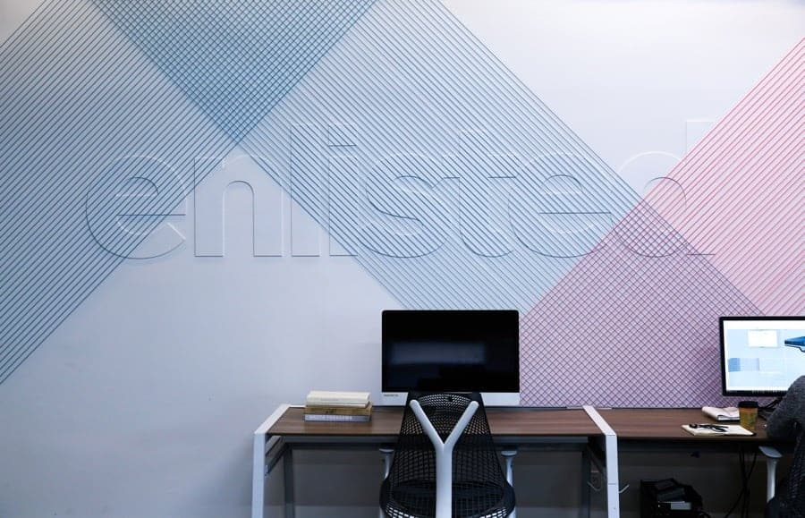 Enlisted Design Logo on office wall