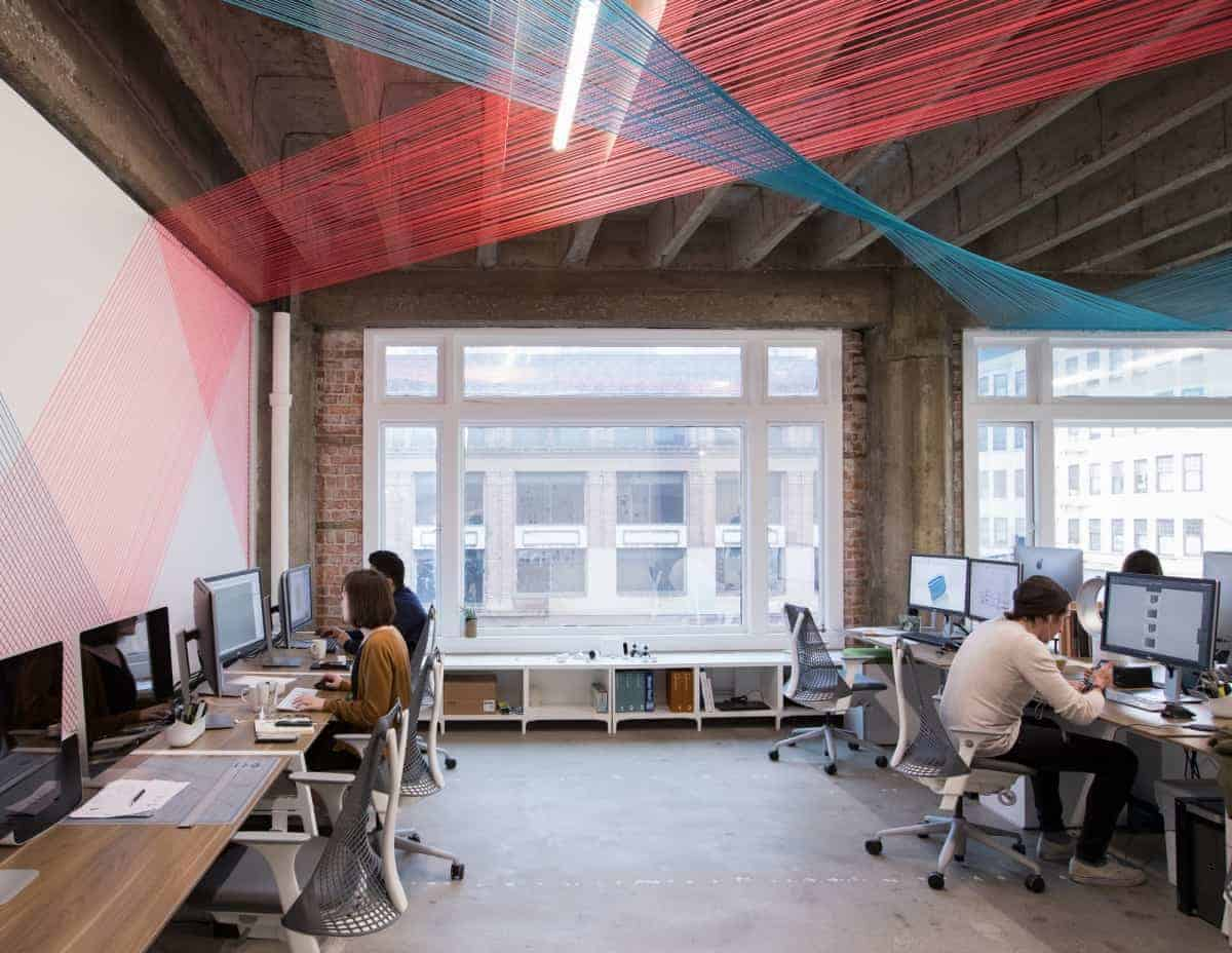 Enlisted Design - Office space with suspended string art