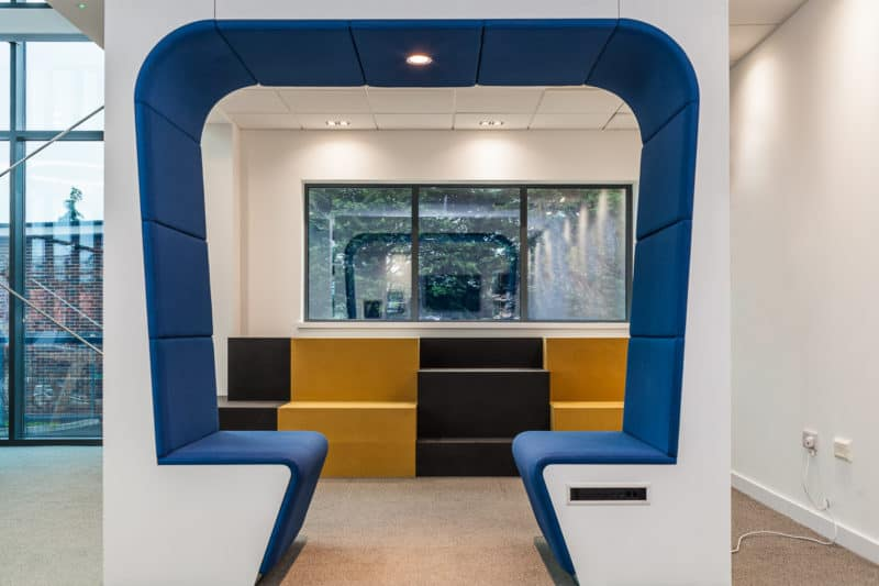 Spotlit Snug Meeting Booth in office setting