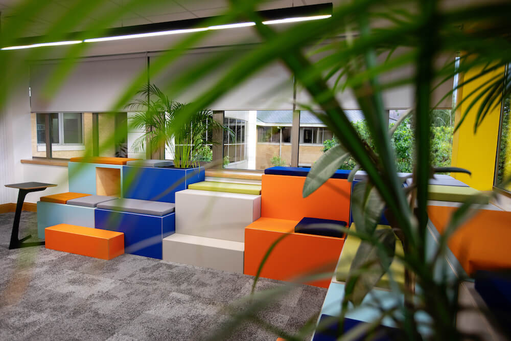 Huddlebox with planters in office