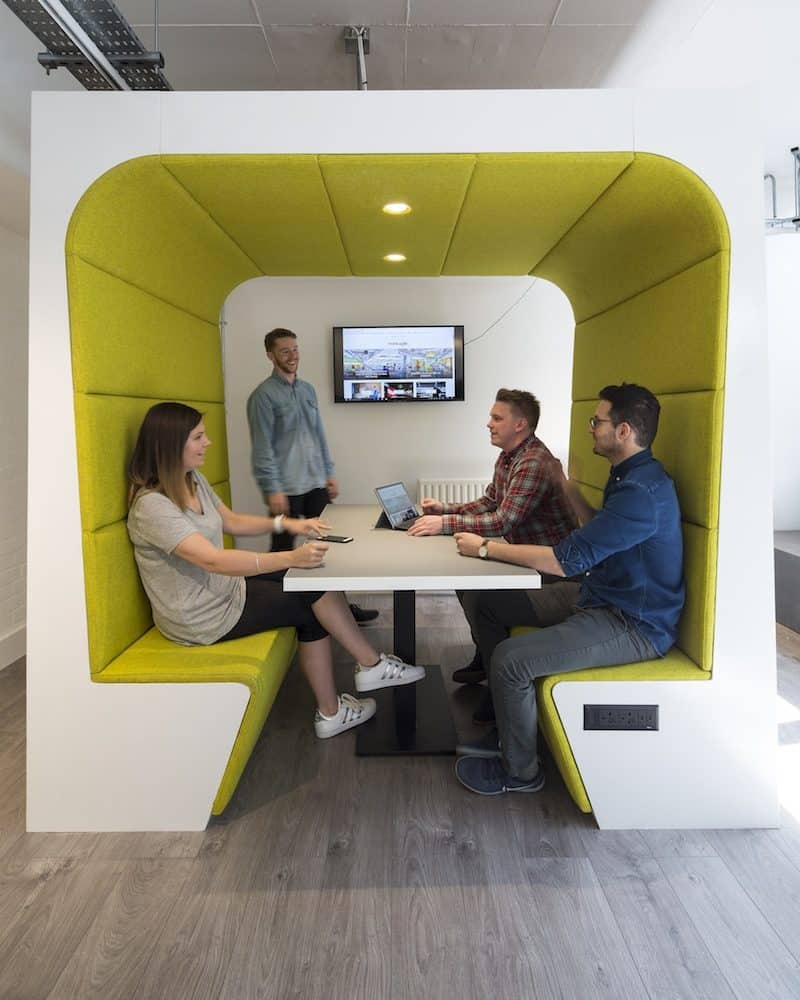 Staff meeting in a Snug booth